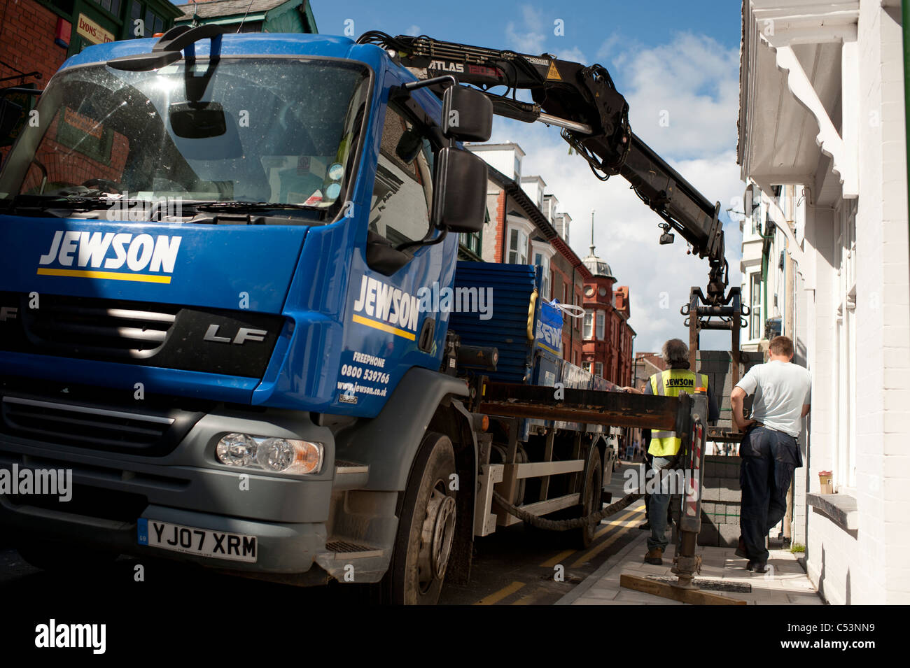 A Jewson truck delivering heavy building supplies, UK - Stock Image