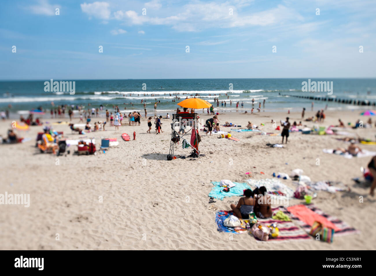 Beachgoers  at Rockaway Beach in the Queens borough of New York Stock Photo