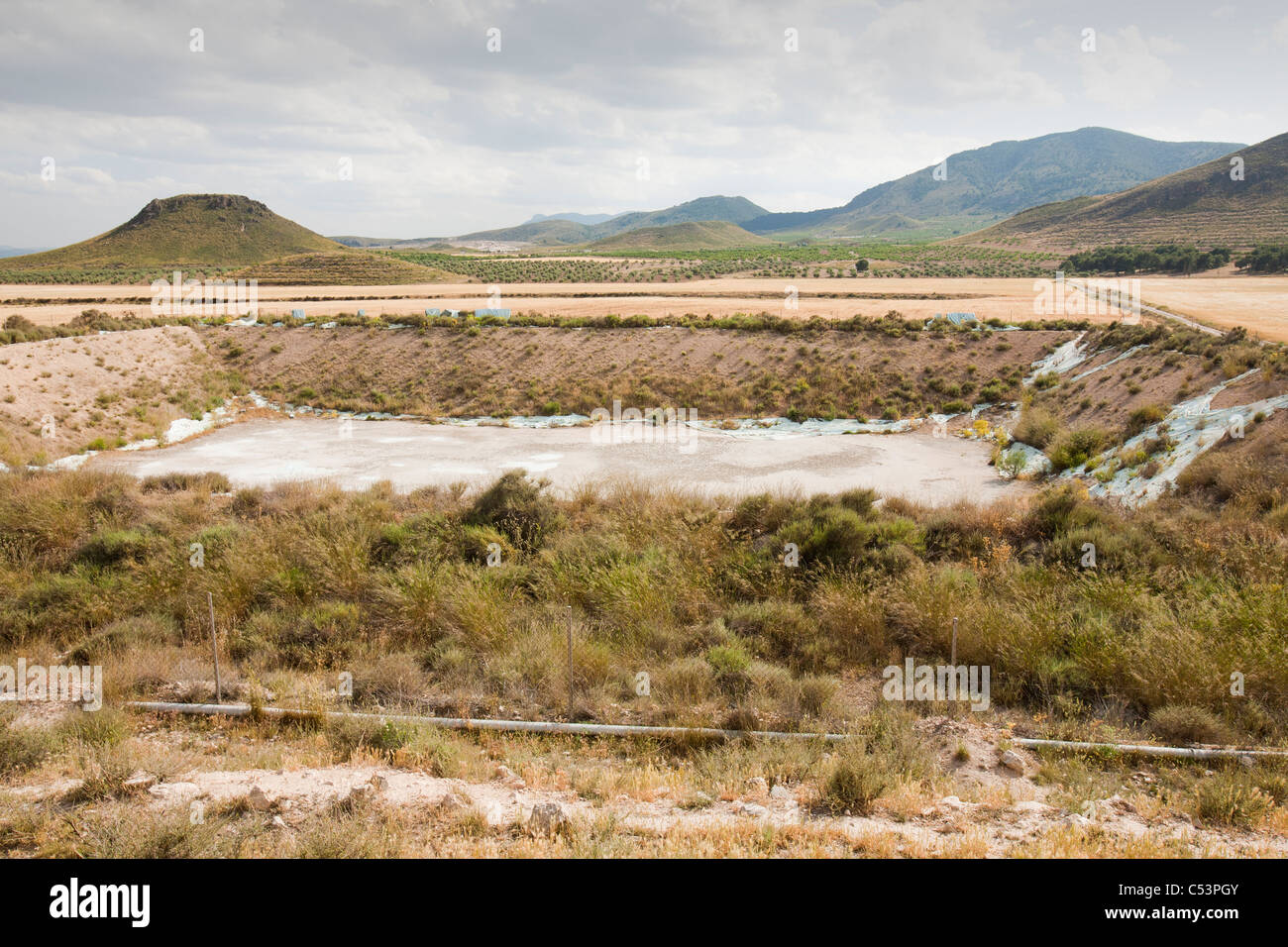 A farmers watering hole completely dried up near Lorca, in Murcia, Spain. - Stock Image