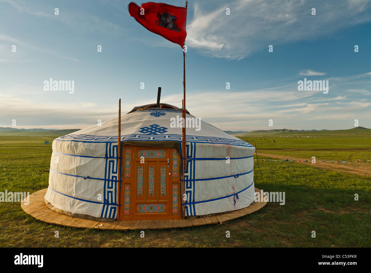 Traditional ger tent home of Mongolian nomads on the grass plains of the steppe - Stock Image