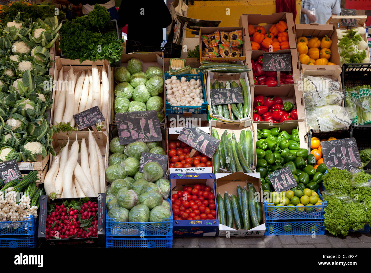 boxes of vegetables and salad veg on market stall - Stock Image