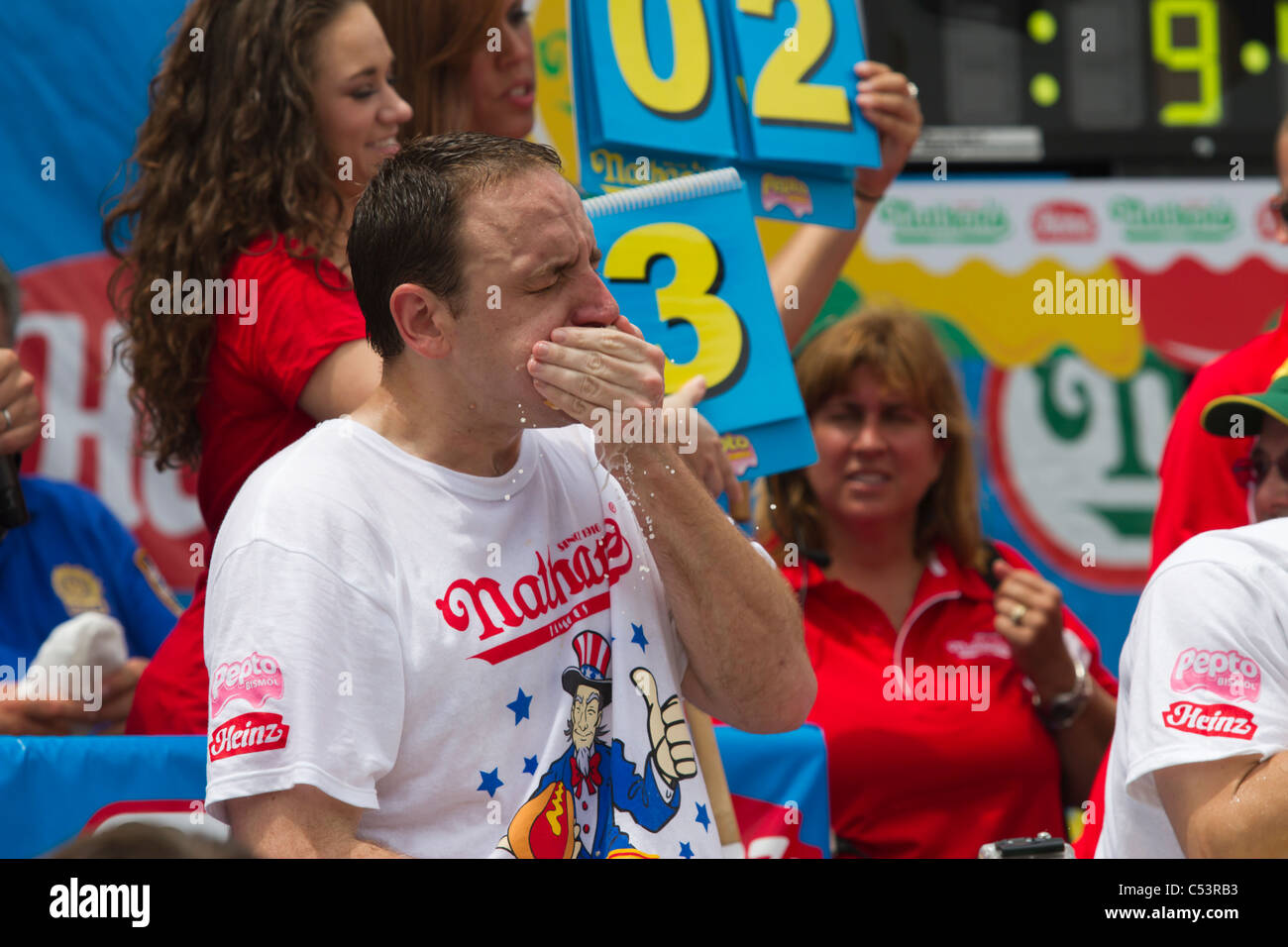Joey Chestnut eating one of the 62 hot dogs that earned him the men's title at the 2011 Nathan's Famous - Stock Image