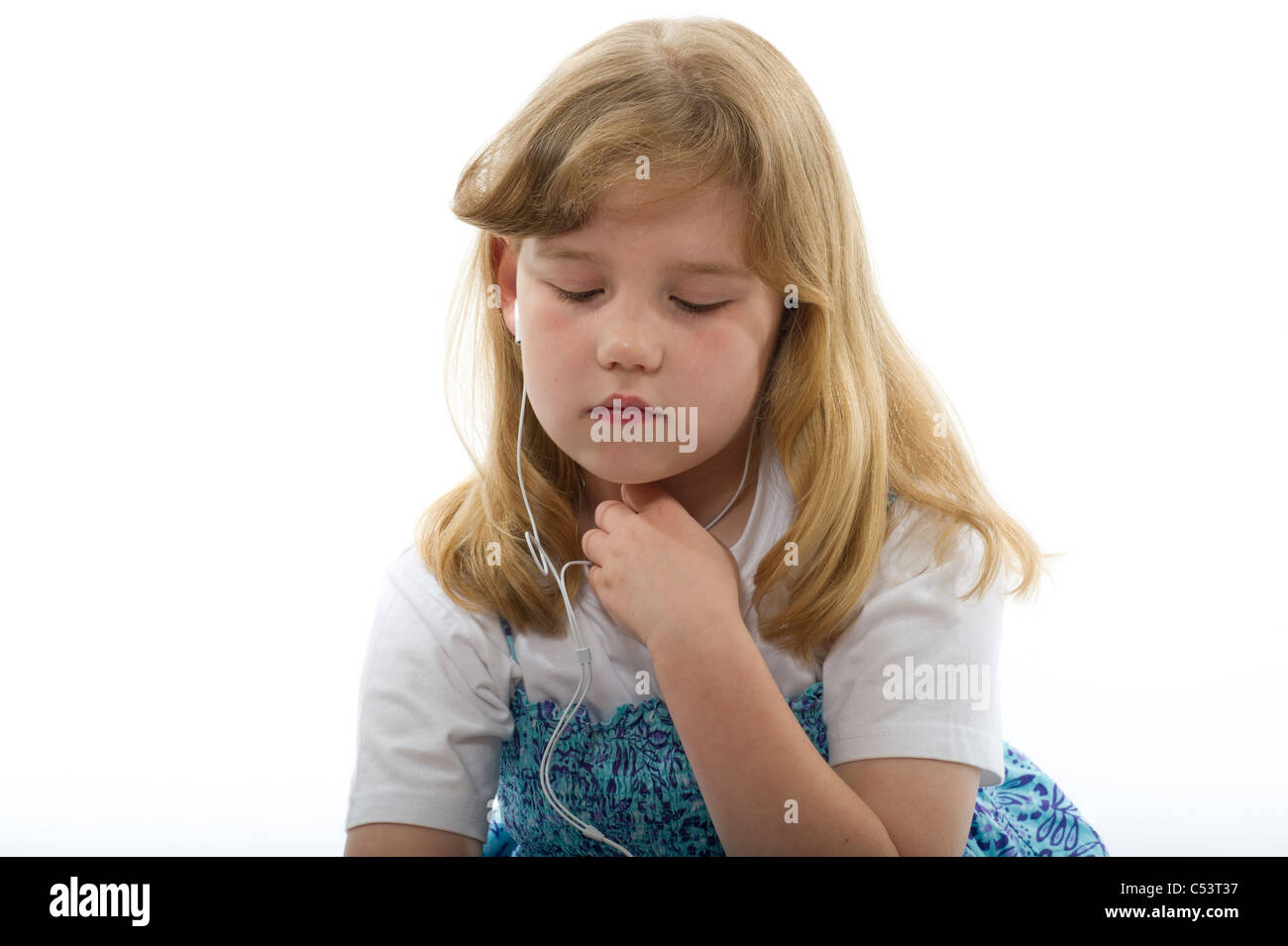A young girl looking thoughtful or sad while listening to