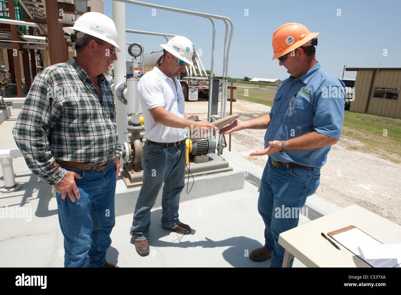 safety officer uses an Alpha detector used to scan worker for possible elevated radiation at an Uranium processing Stock Photo