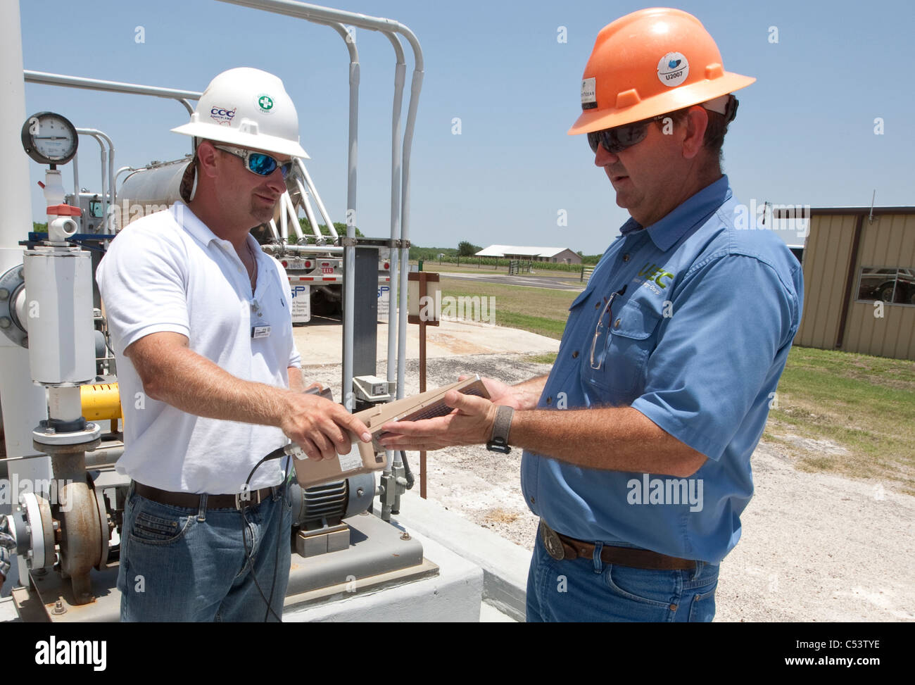 safety officer uses an Alpha detector used to scan worker for possible elevated radiation at an Uranium processing - Stock Image