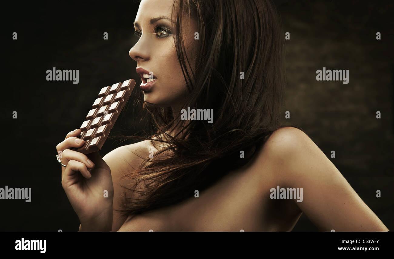 Gorgeous woman holding chocolate - Stock Image