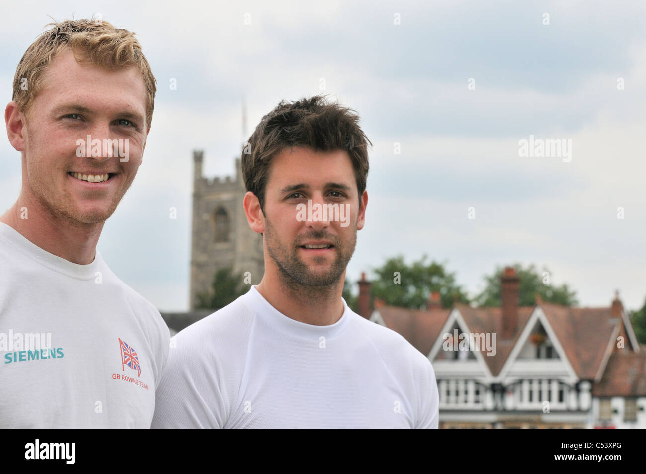 Britain's Olympic gold medallists Alex Gregory Tom James, Henley Royal Regatta in boat tent area with the town of - Stock Image