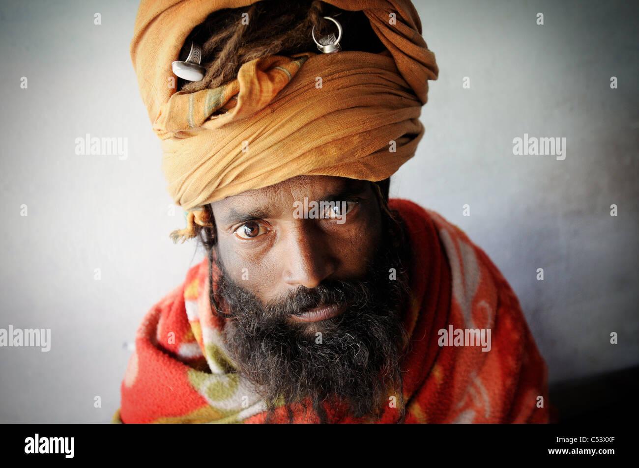 A sadhu (Hindu holy man) at the Kumbh Mela festival in India. - Stock Image