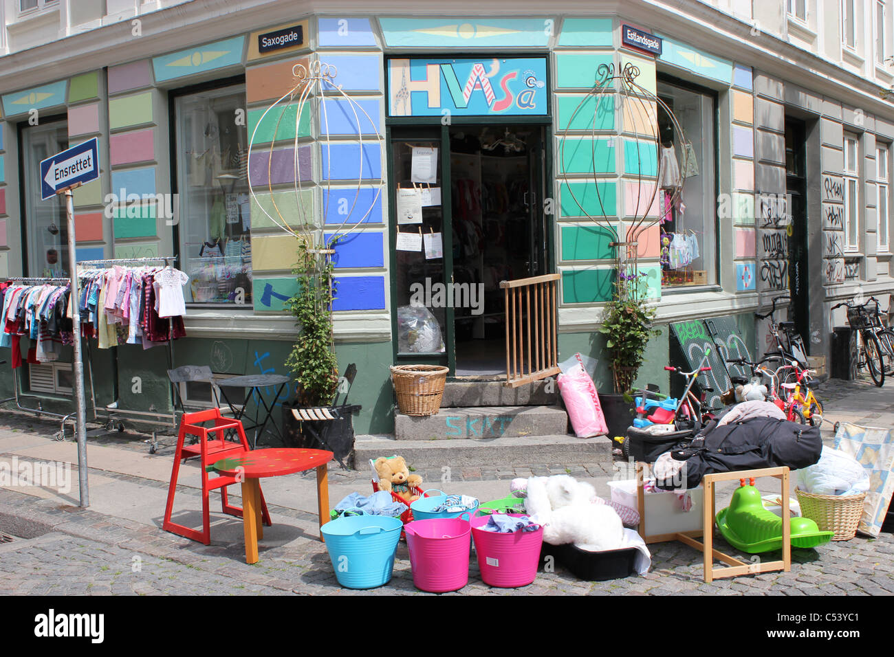 Secondhand shop selling children´s clothes and toys in Vesterbro,  Copenhagen, Denmark - Stock Image