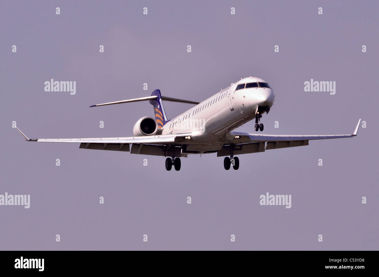 Bombardier CRJ-900 NextGen operated by Eurowings (Lufthansa Regional) on approach for landing at Birmingham Airport, - Stock Image