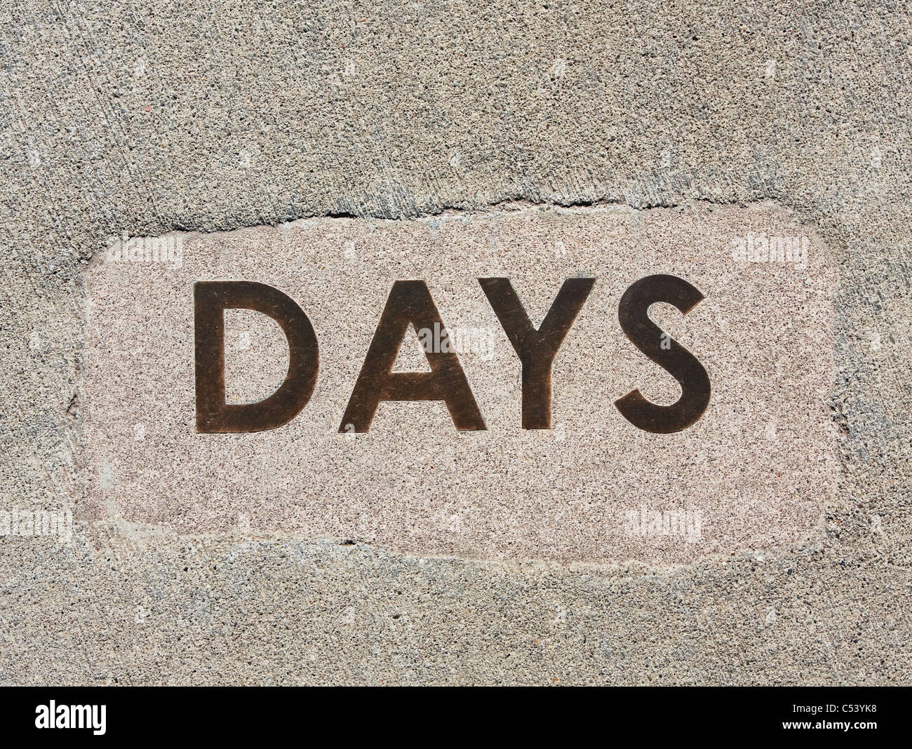 word days cast in concrete - Stock Image