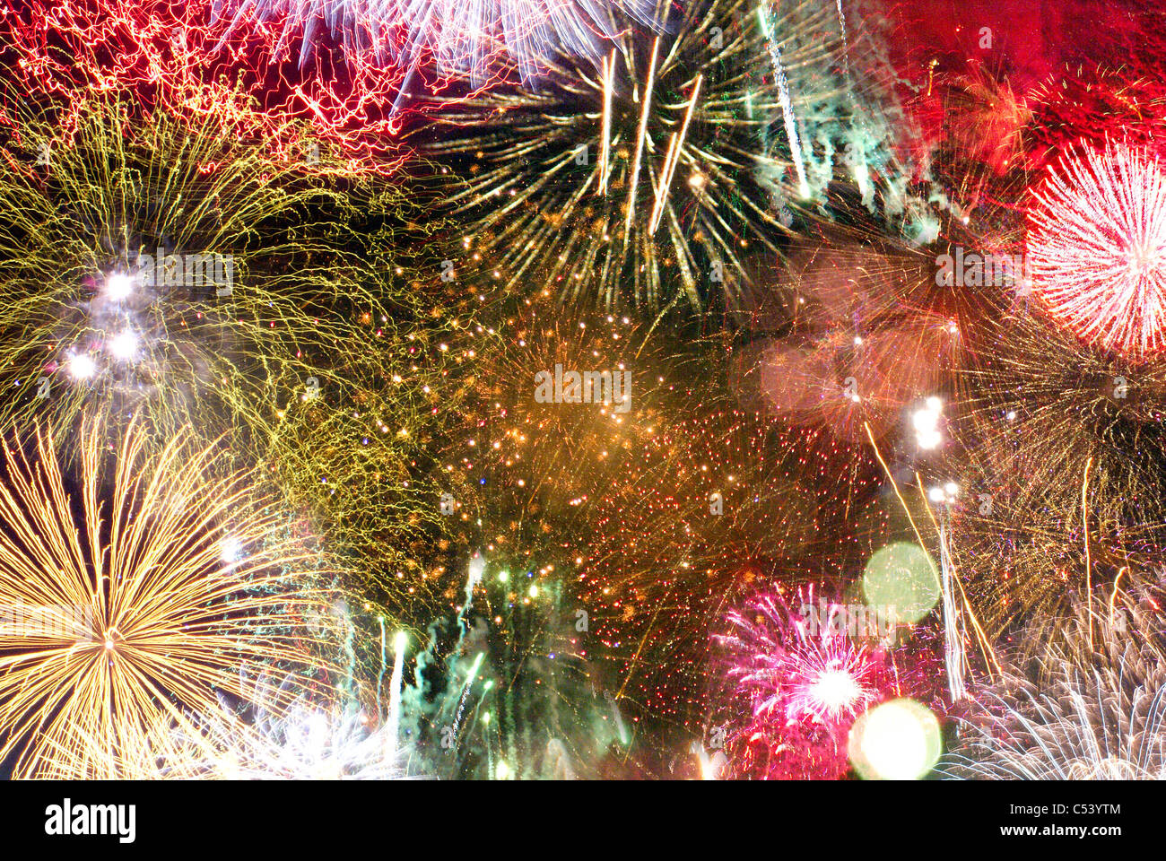 Background type image showing many bursts of fireworks. - Stock Image