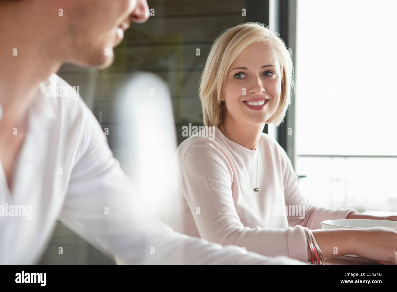 Woman looking at her husband and smiling - Stock Image