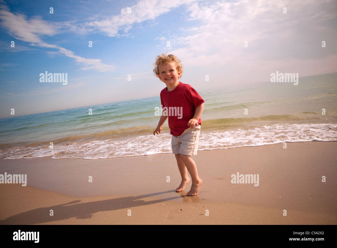 Child on the beach - Stock Image