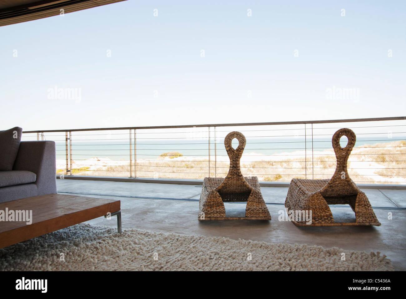 View of beach seen through balcony - Stock Image