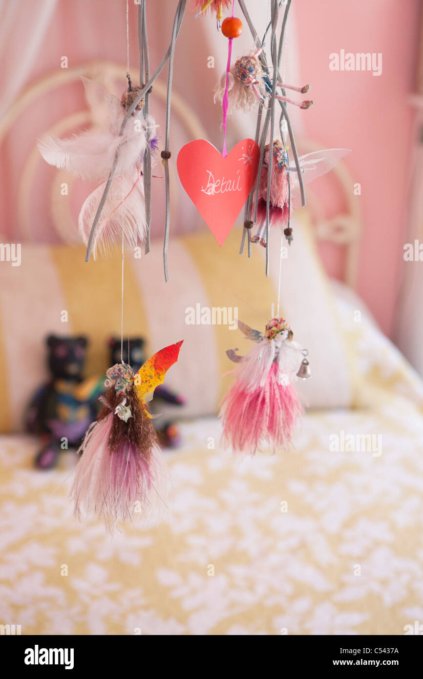Close-up of wind chime decorated in a bedroom - Stock Image