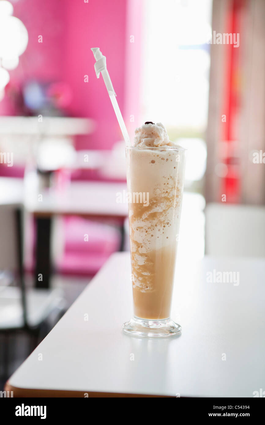 Chocolate milkshake placed on a table in a restaurant Stock Photo