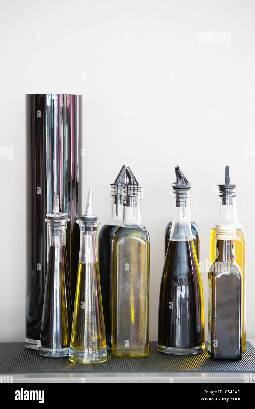 Assorted cooking oil bottles in a restaurant - Stock Image