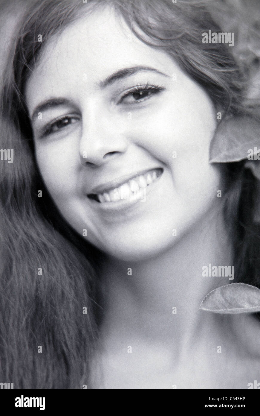 Smiling face of young woman - Stock Image