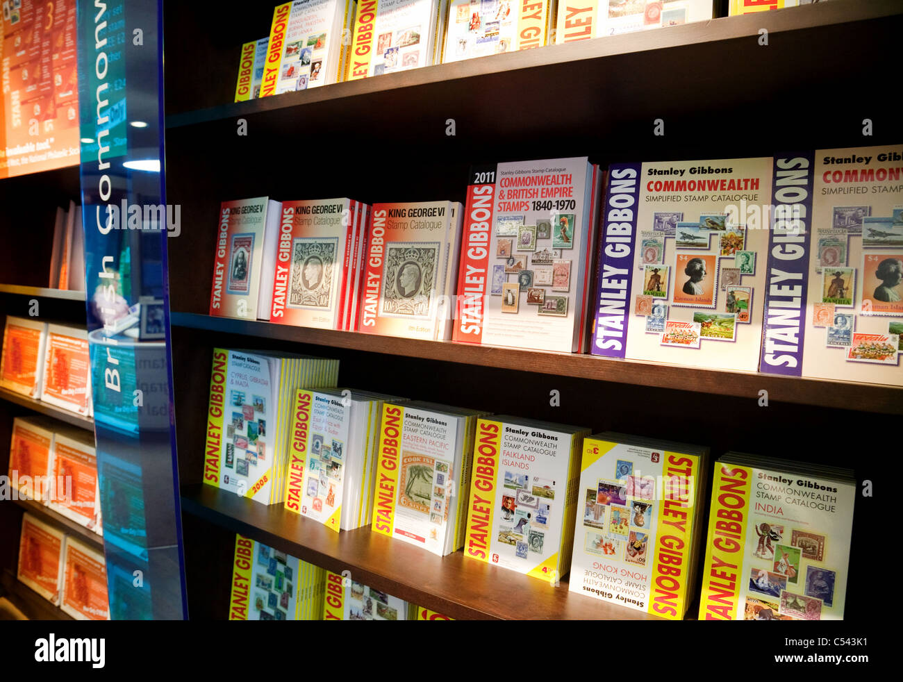 Stamp Catalogues on the shelf at Stanley Gibbons store on the Strand, London UK - Stock Image