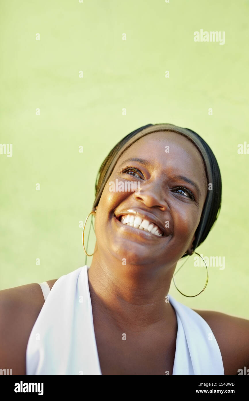 portrait of happy african adult woman looking up and smiling. Vertical shape, copy space Stock Photo