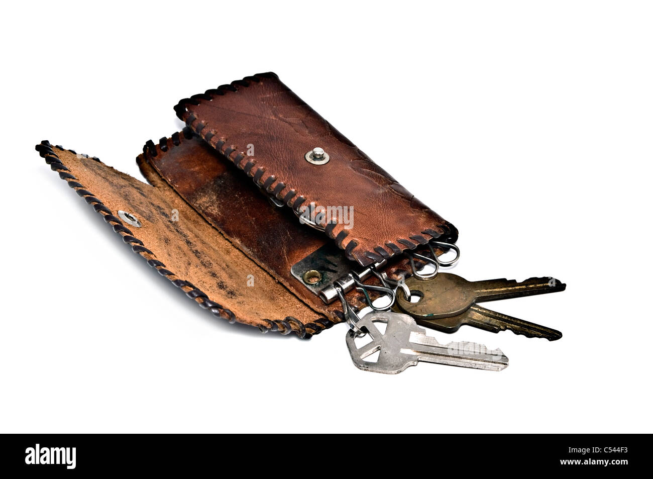 An old handmade leather wallet for keys. Stock Photo