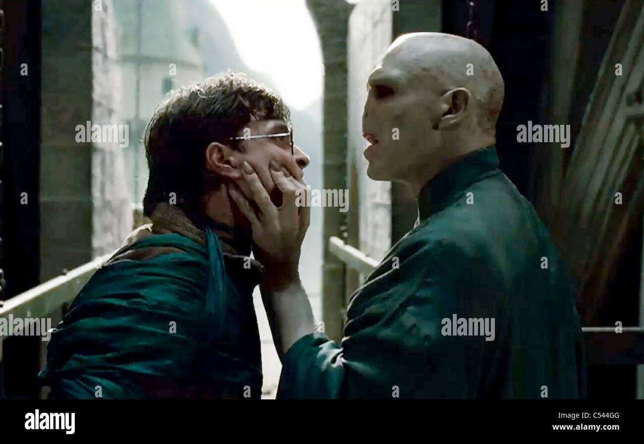 HARRY POTTER AND THE DEATHLY HALLOWS: PART 1  - 2010 Warner Bros film with Daniel Radcliffe at left and Ralph Fiennes - Stock Image