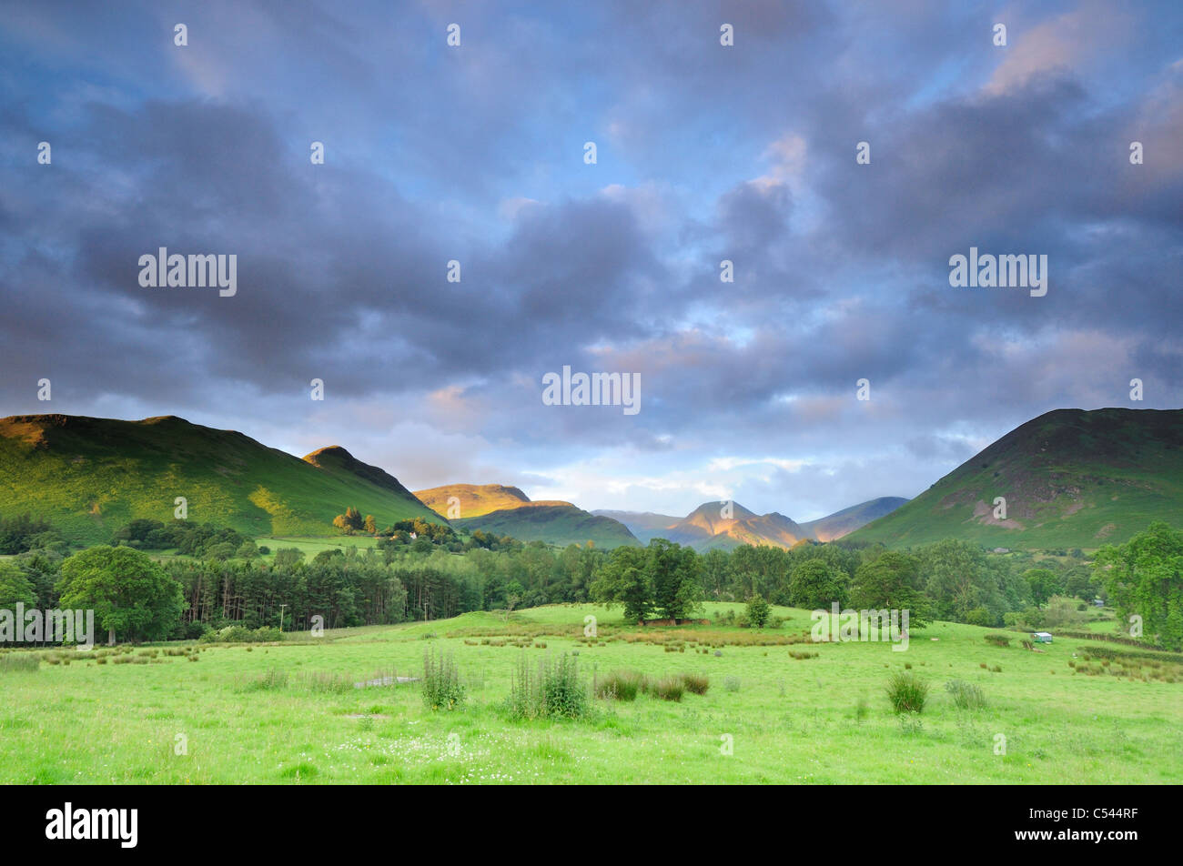 Dramatic cloud over the Newlands Valley in the English Lake District, with sunlit Maiden Moor and Hindscarth in - Stock Image