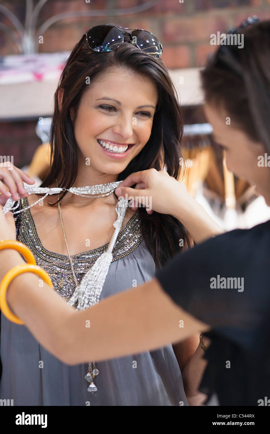 Two beautiful young women shopping at a mall - Stock Image