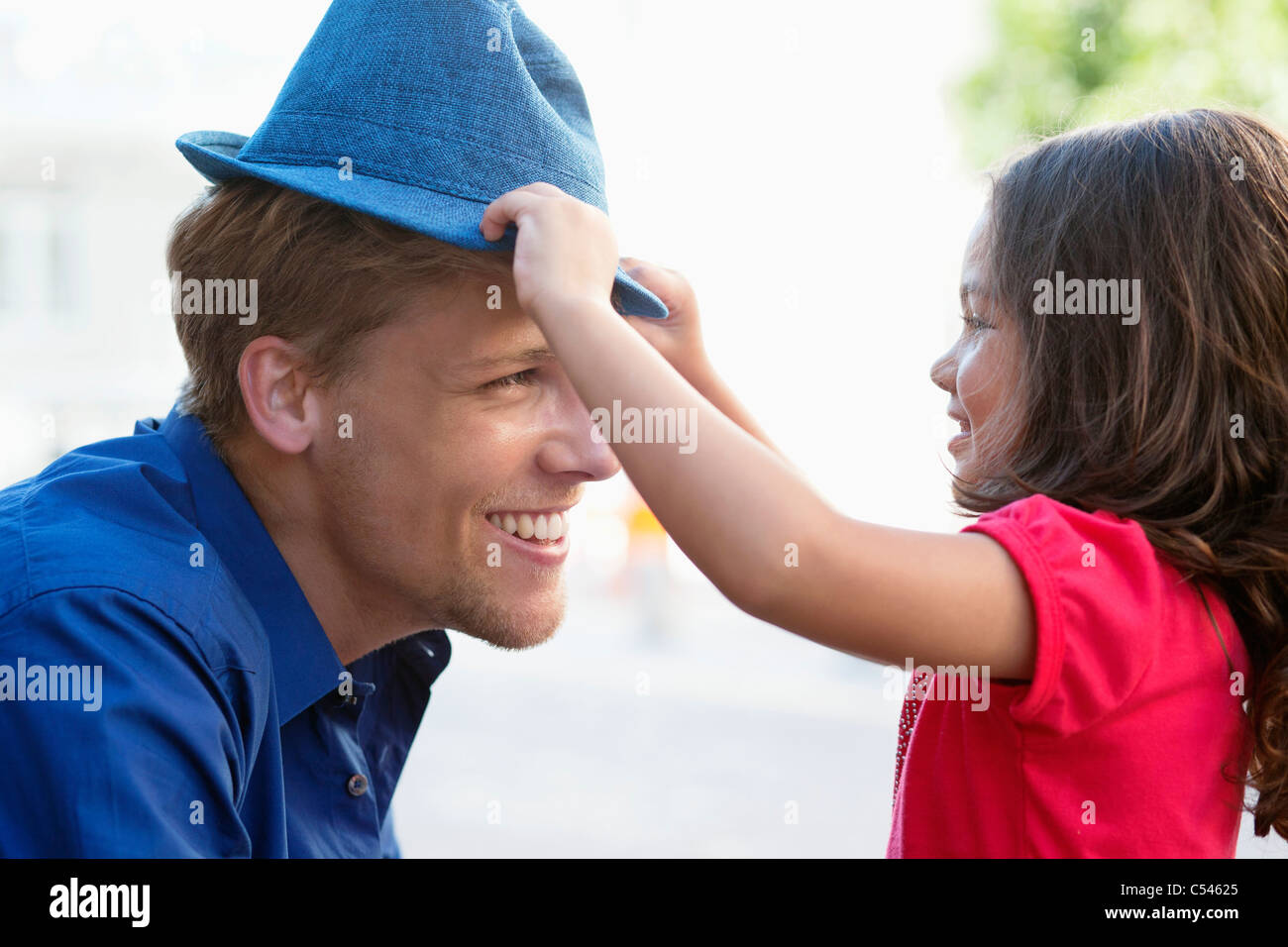 c92b4b31 Putting On A Hat Stock Photos & Putting On A Hat Stock Images - Alamy