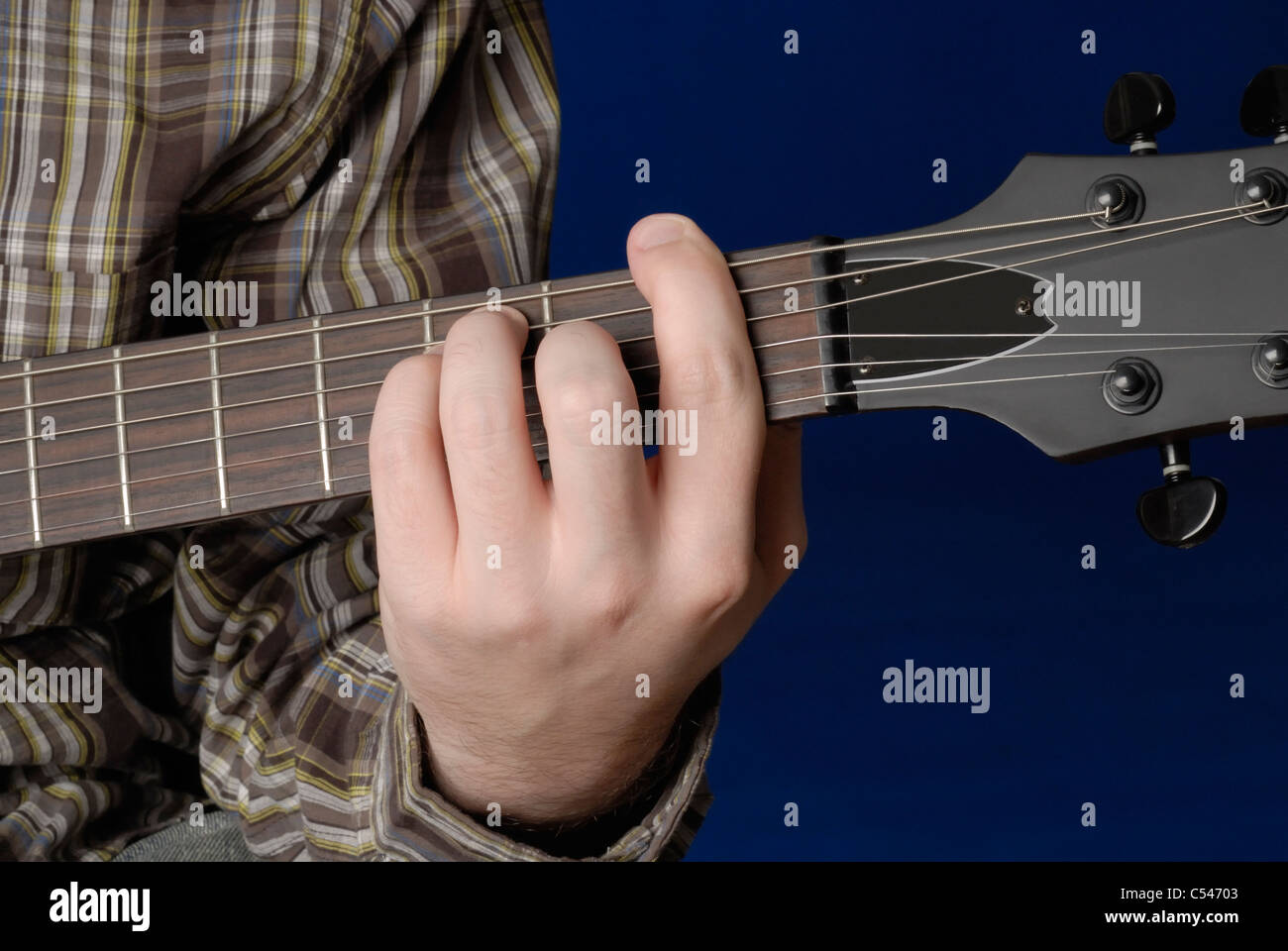 Mans Hand Demonstrating F Bar Chord On Guitar Stock Photo 37587315