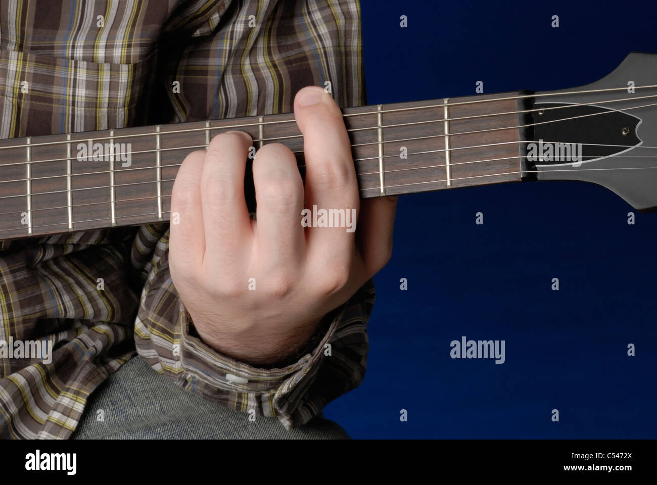 Mans Hand Demonstrating A G Bar Chord On Guitar Stock Photo