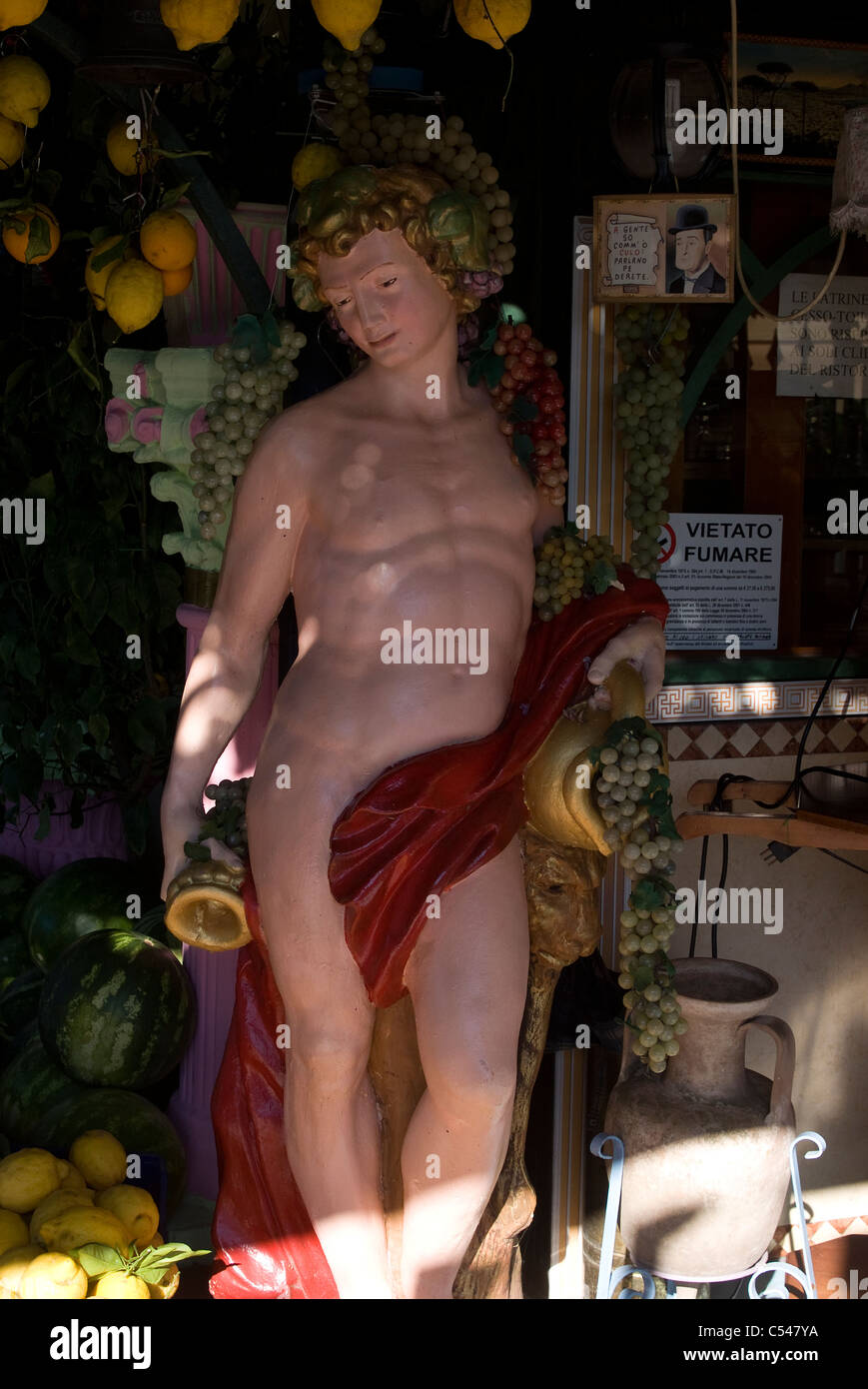 A modern recreation of the Roman god Bacchus at a local cafe, Pompeii, Campania, Italy - Stock Image