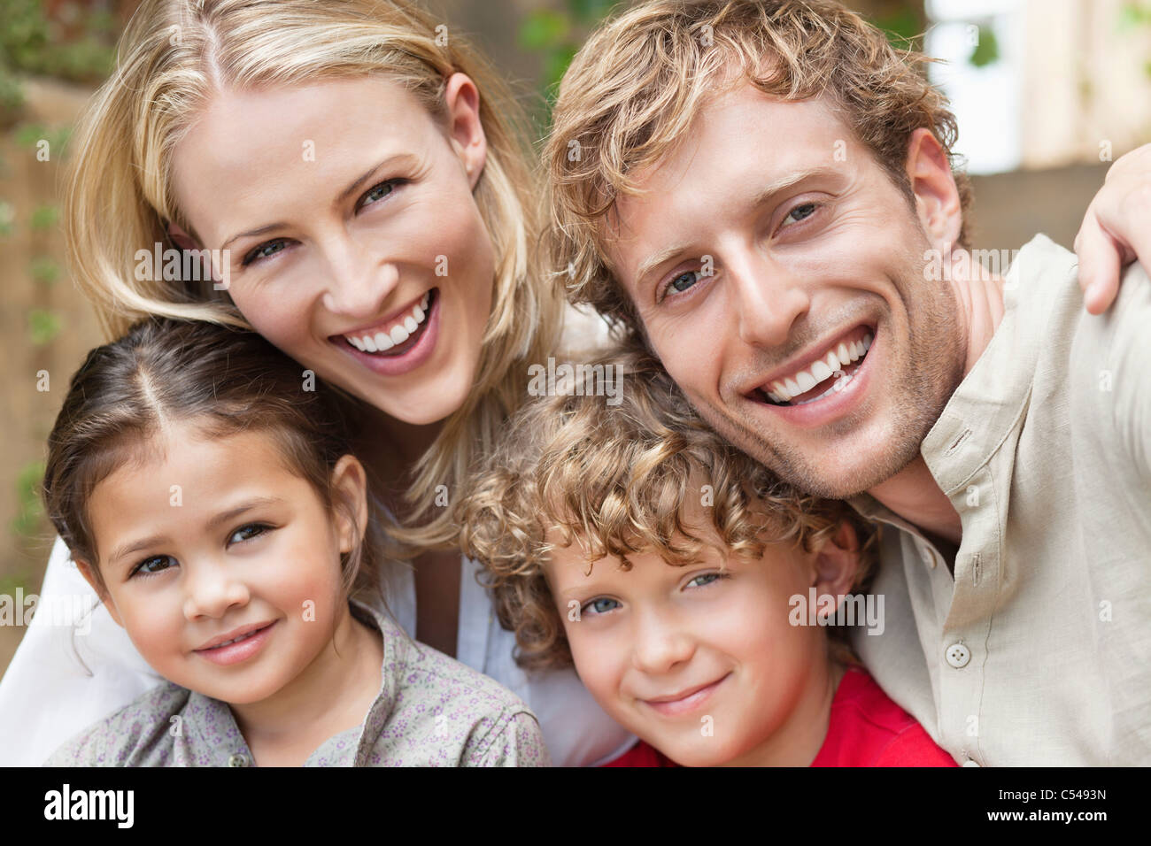 Portrait of a family with two children - Stock Image