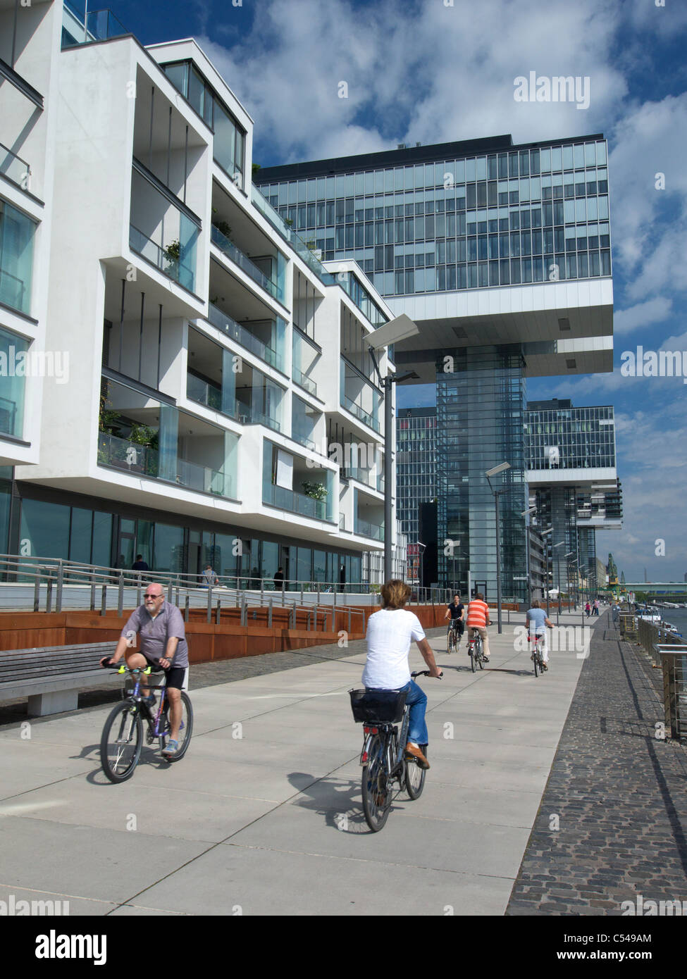 Modern Rheinauhafen property development along Rhine riverbank in Cologne Germany Stock Photo