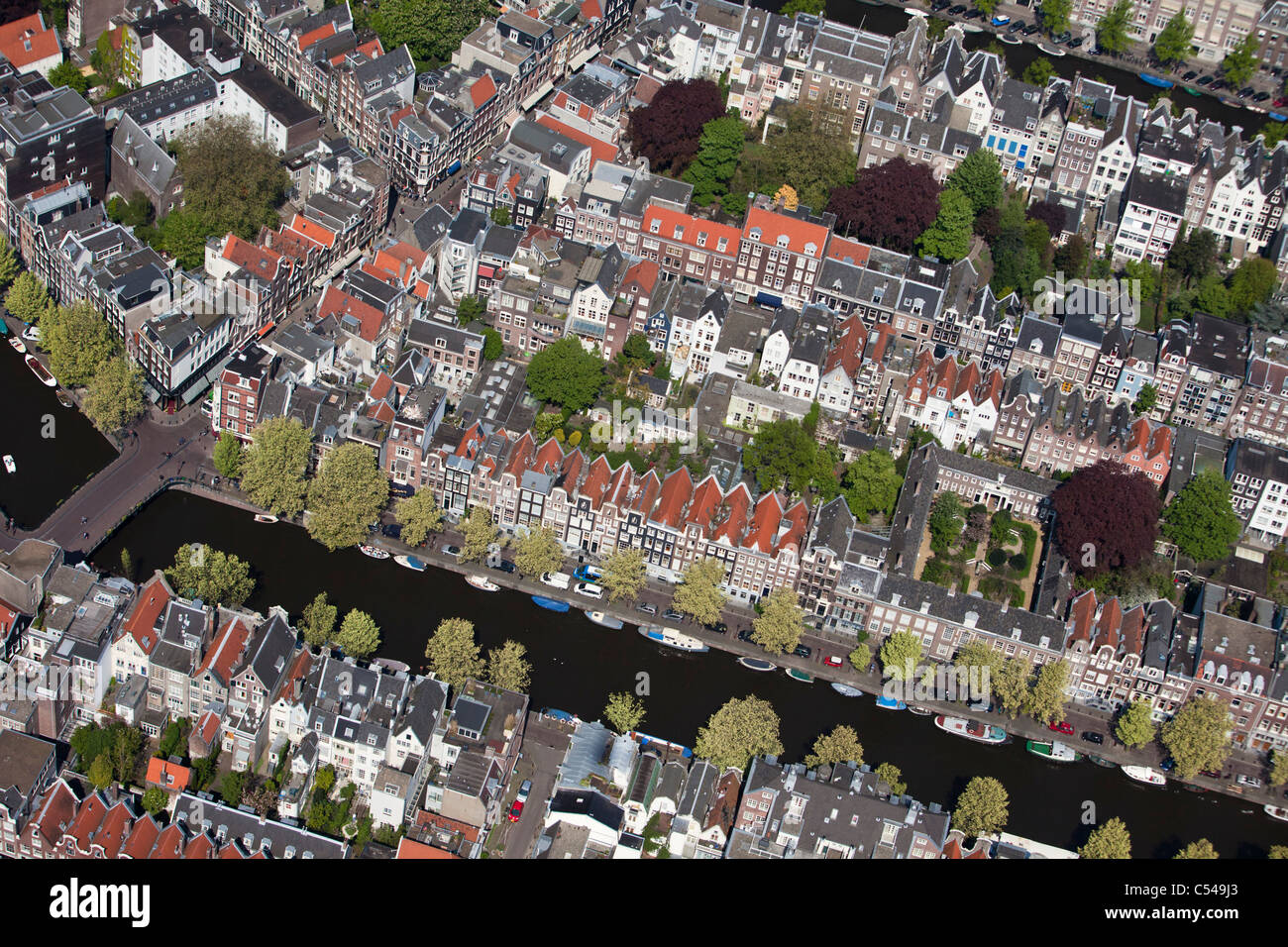 The Netherlands, Amsterdam, Aerial of canals and city centre. Unesco World Heritage Site. - Stock Image