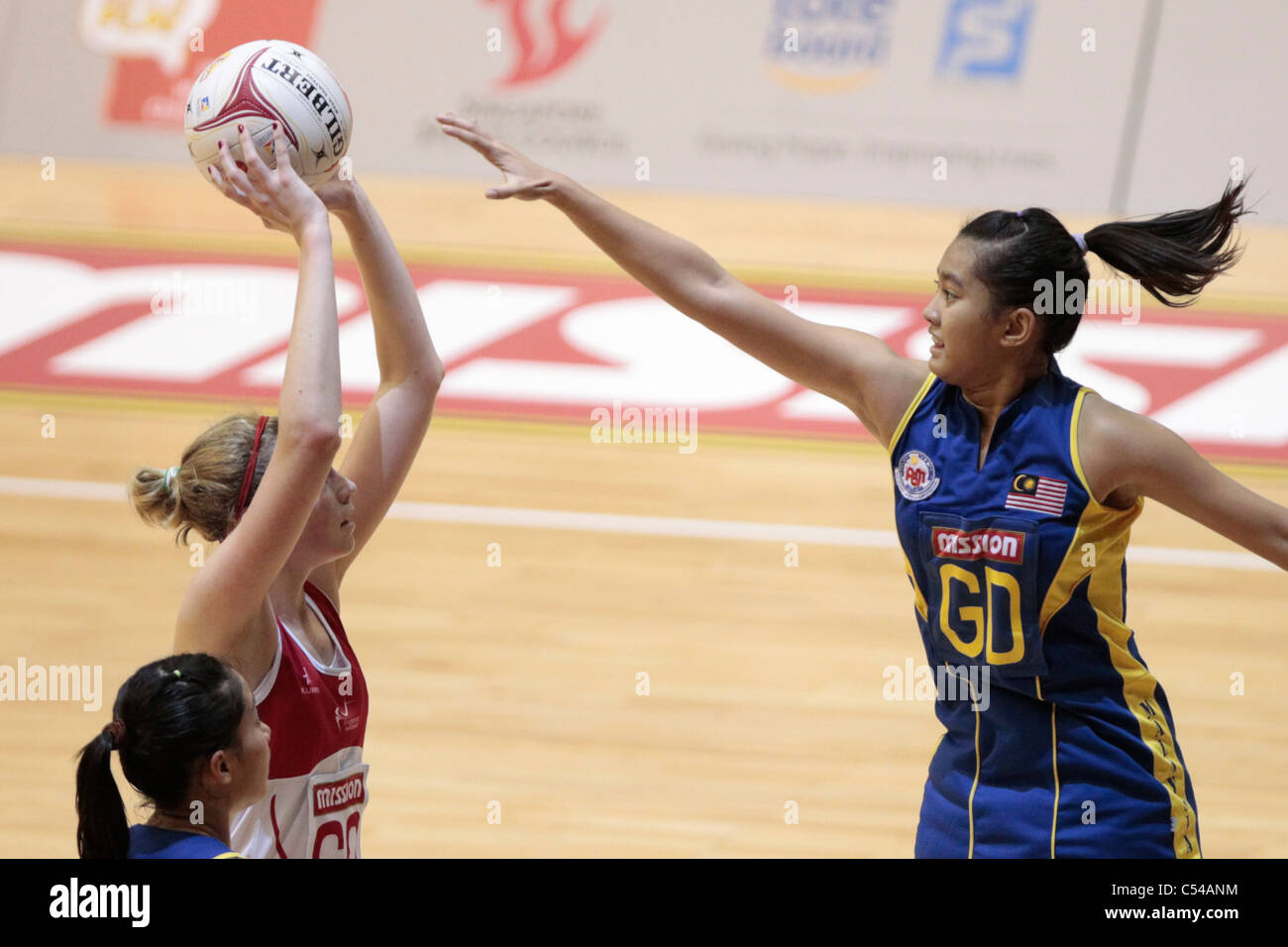 06.07.2011 Noramirah Dayana of Malaysia(right) goes in for the block on Joanne Harten during the Pool D match between - Stock Image