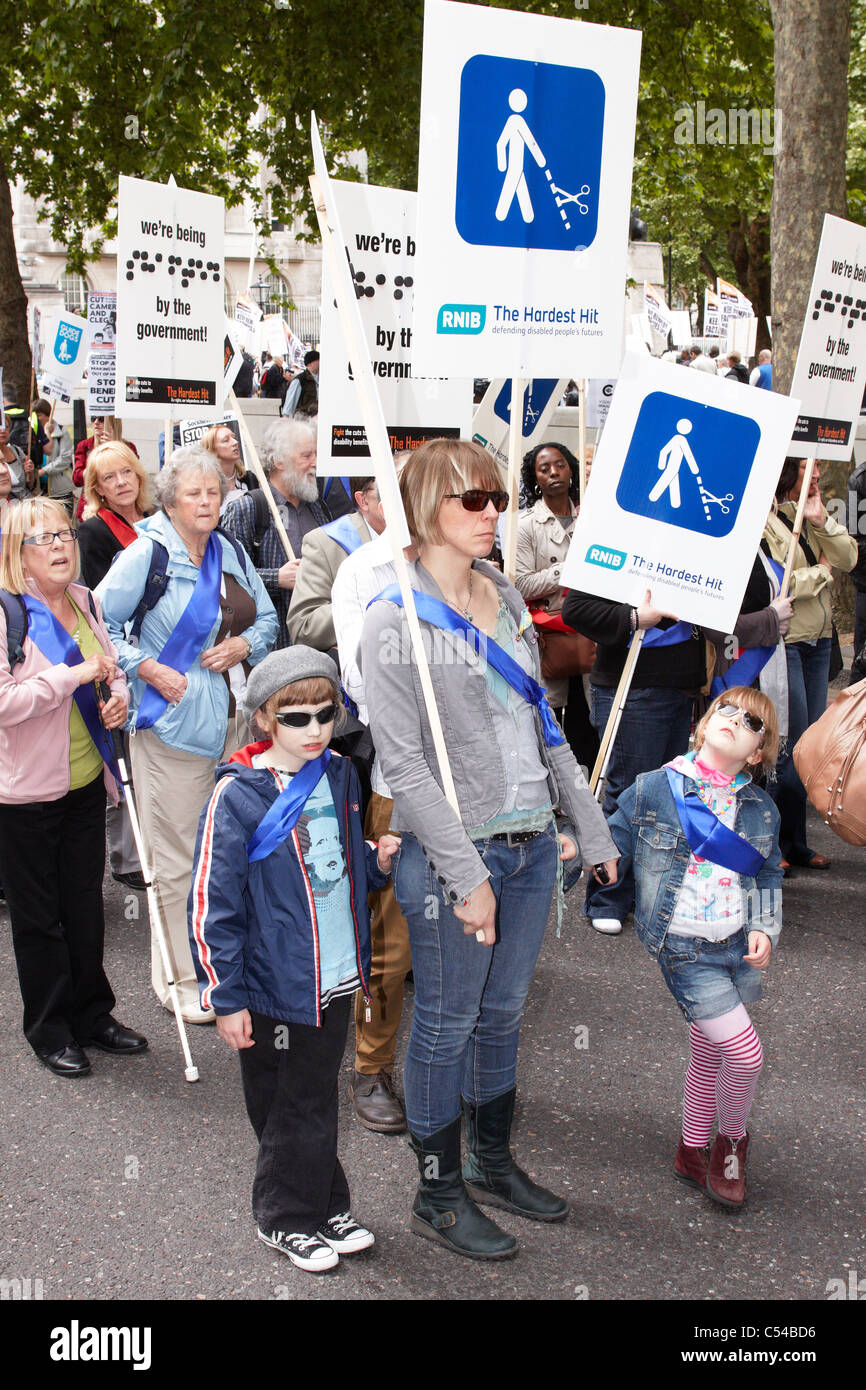 Thousands of disabled people march past Parliament to protest against cuts in  support offered to the handicapped - Stock Image