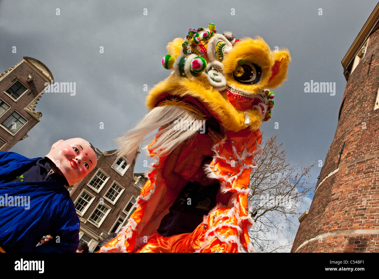 The Netherlands, Amsterdam, Celebrating Chinese New Year on square called Nieuwmarkt. - Stock Image