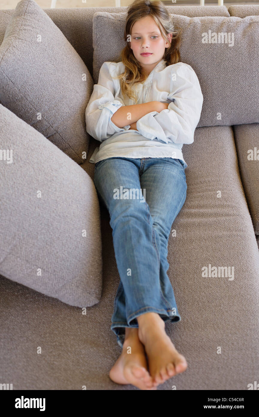 High Angle View Of A Girl Lying On A Couch Stock Image