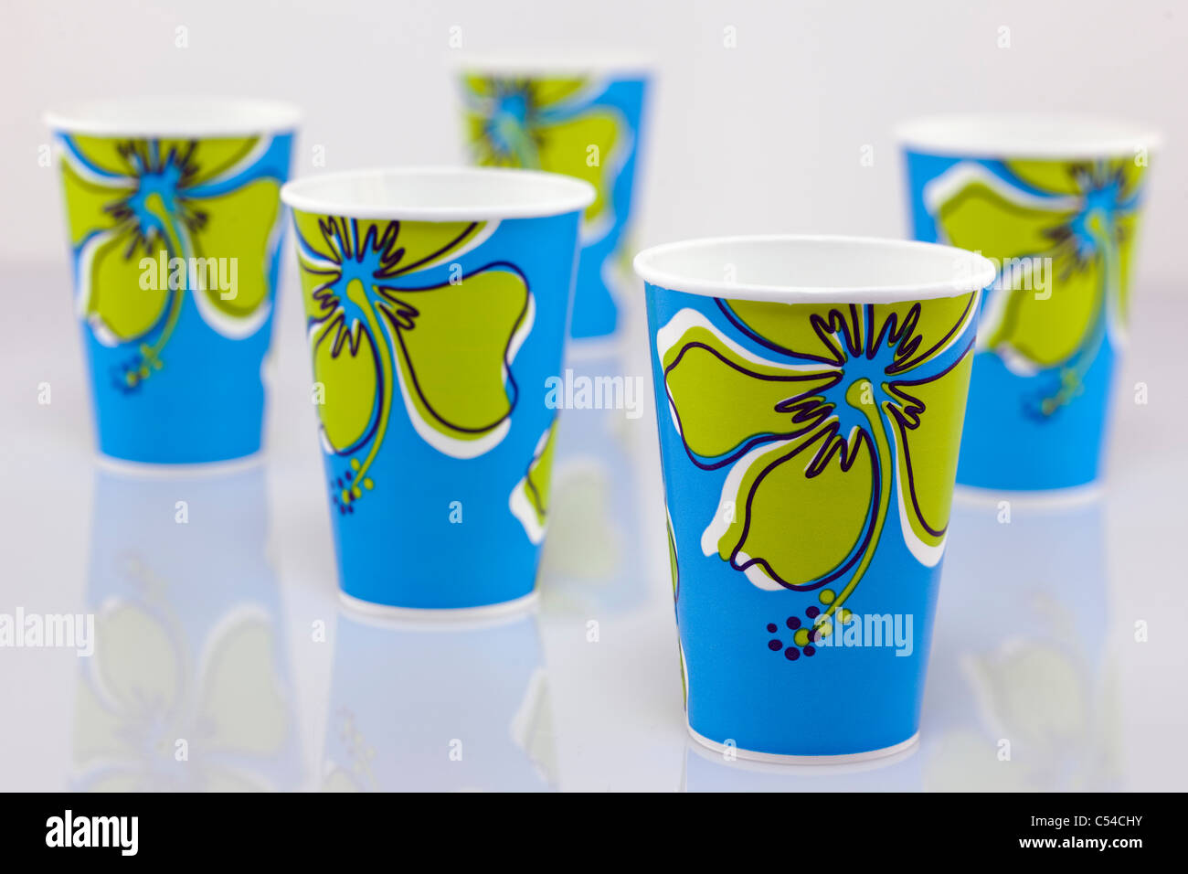 Five blue and green patterned paper cups - Stock Image