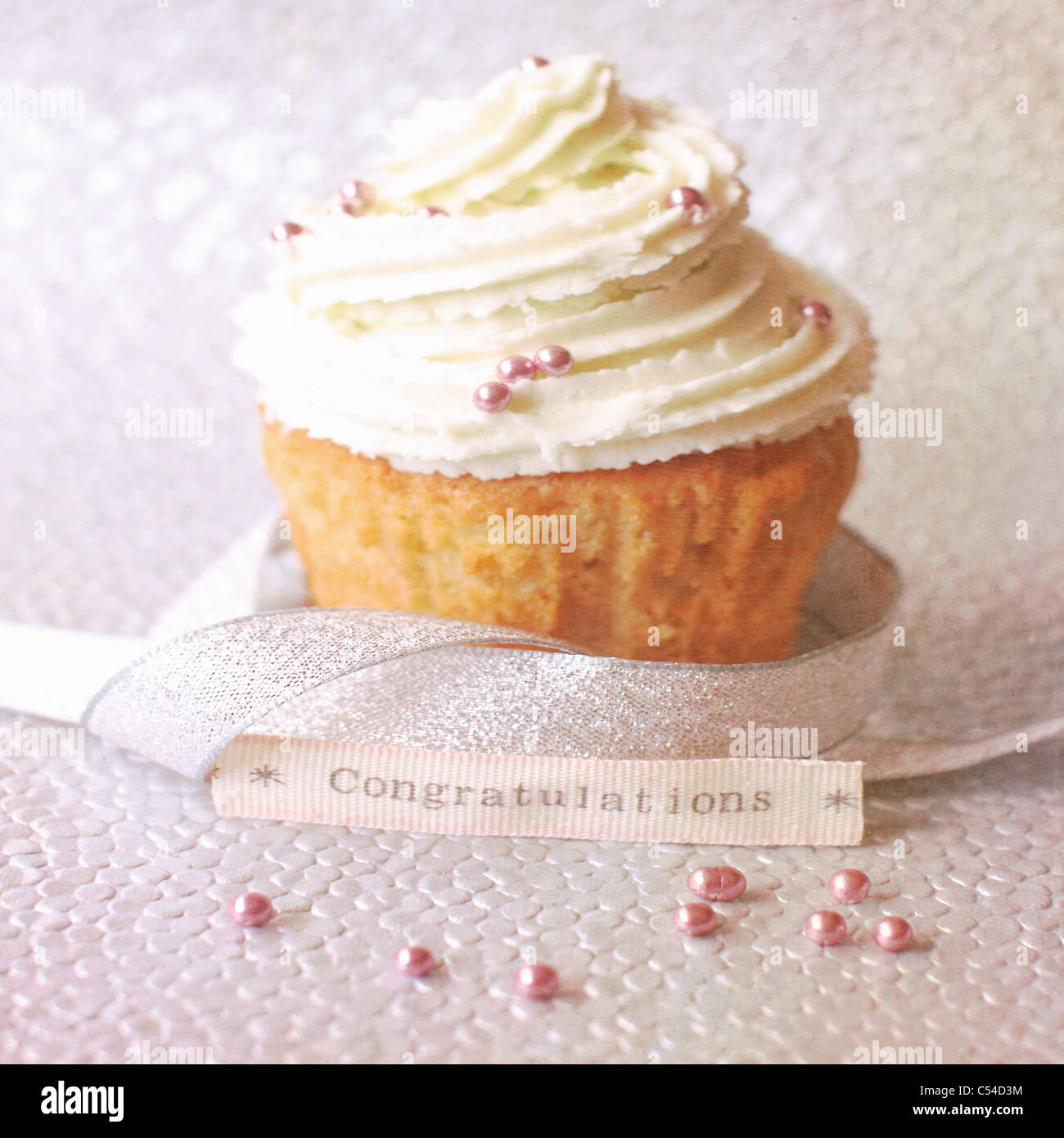 Cupcake on a Silver Bokeh Background - Stock Image