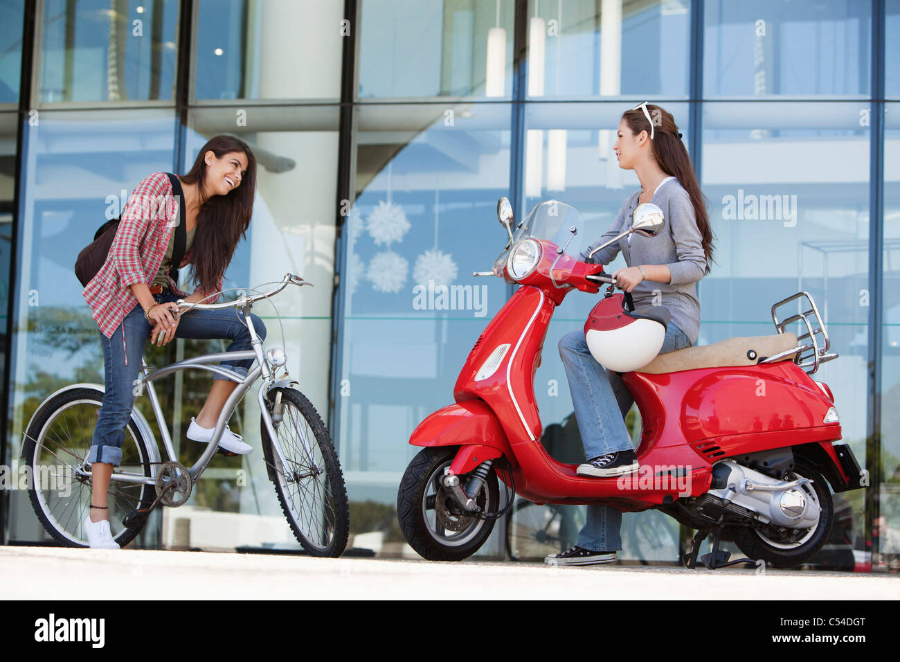Two female friends having a friendly conversation - Stock Image