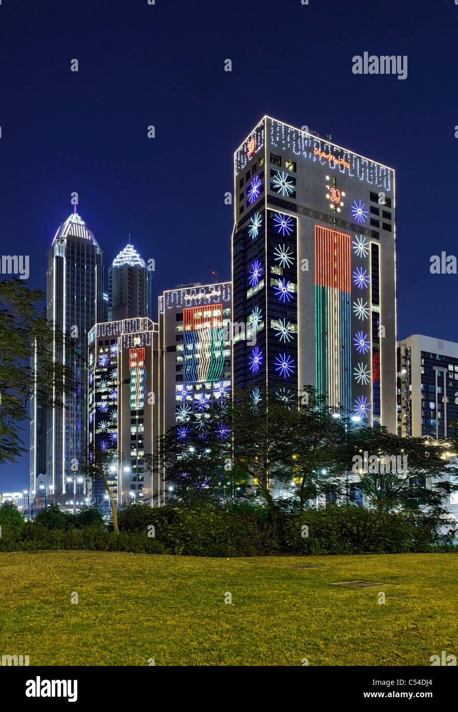 High-rise buildings on Corniche Road, illuminated with LED lights, Abu Dhabi, Corniche, Al Hosn, Emirate of Abu Stock Photo