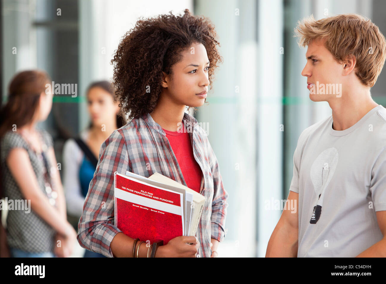 Two university students discussing in campus - Stock Image