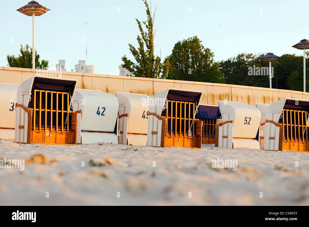 Roofed wicker beach chairs, beach, Baltic Sea, sunset, seaside resort of Ostseeheilbad Heiligendamm, Germany - Stock Image