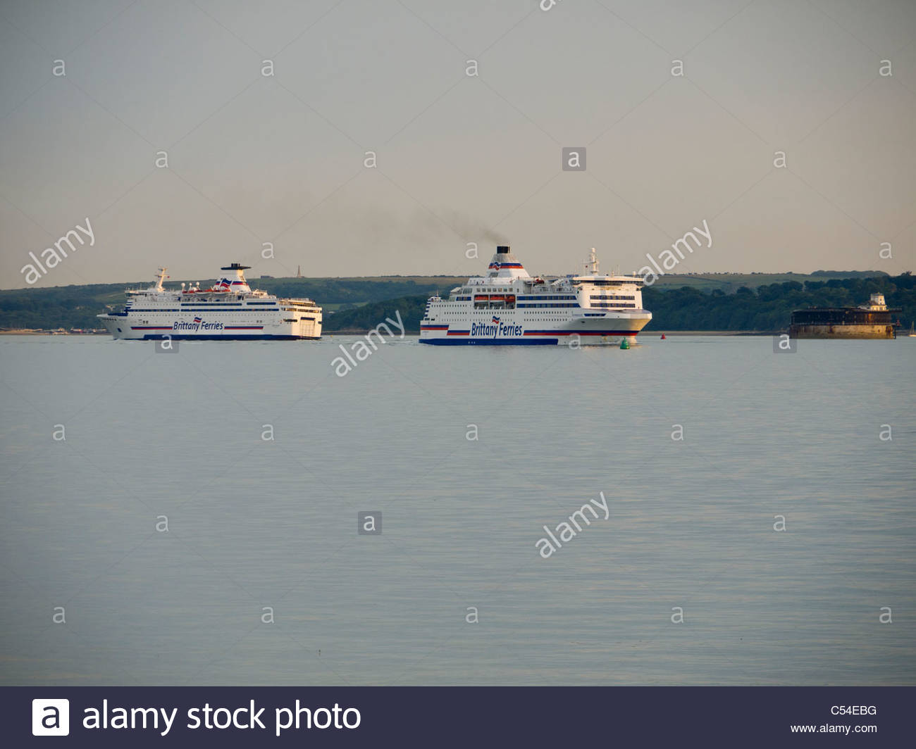 Portsmouth Southsea Brittany Ferries inbound Normandie passes outbound Bretange - Stock Image