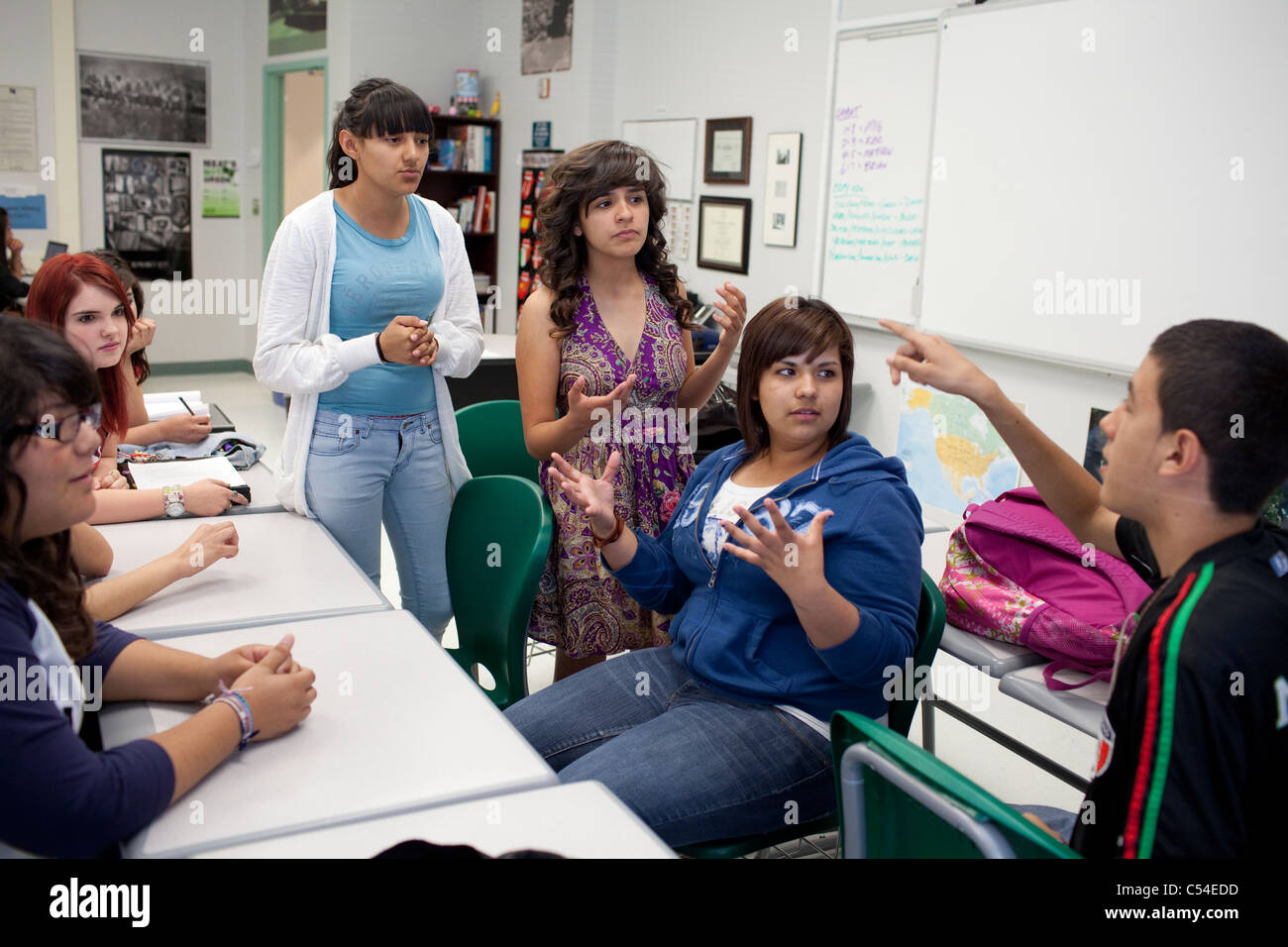 Group of students in discussion in El Paso, Texas high school classroom - Stock Image