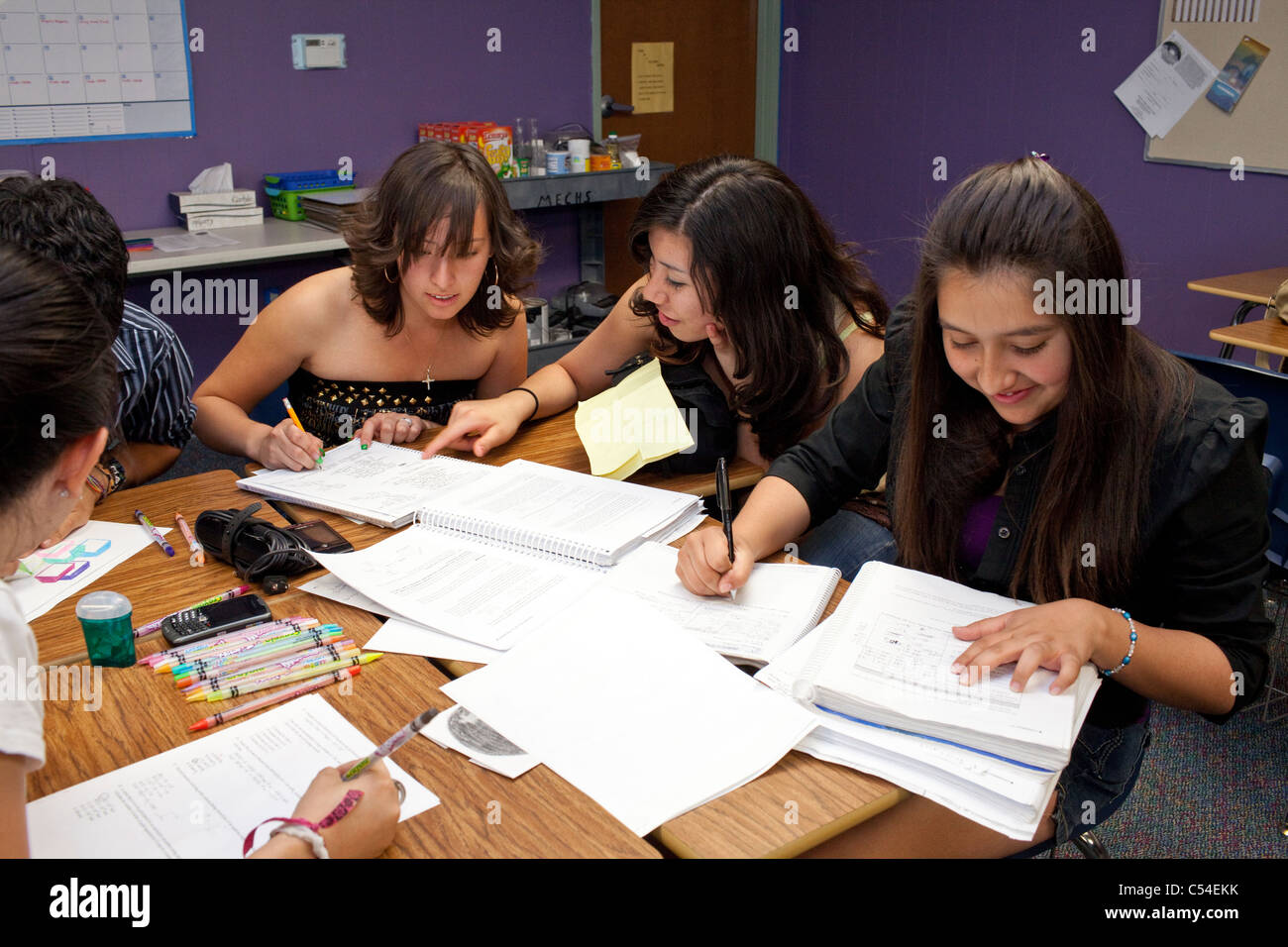 Group of students work together on project in El Paso, Texas high school classroom - Stock Image