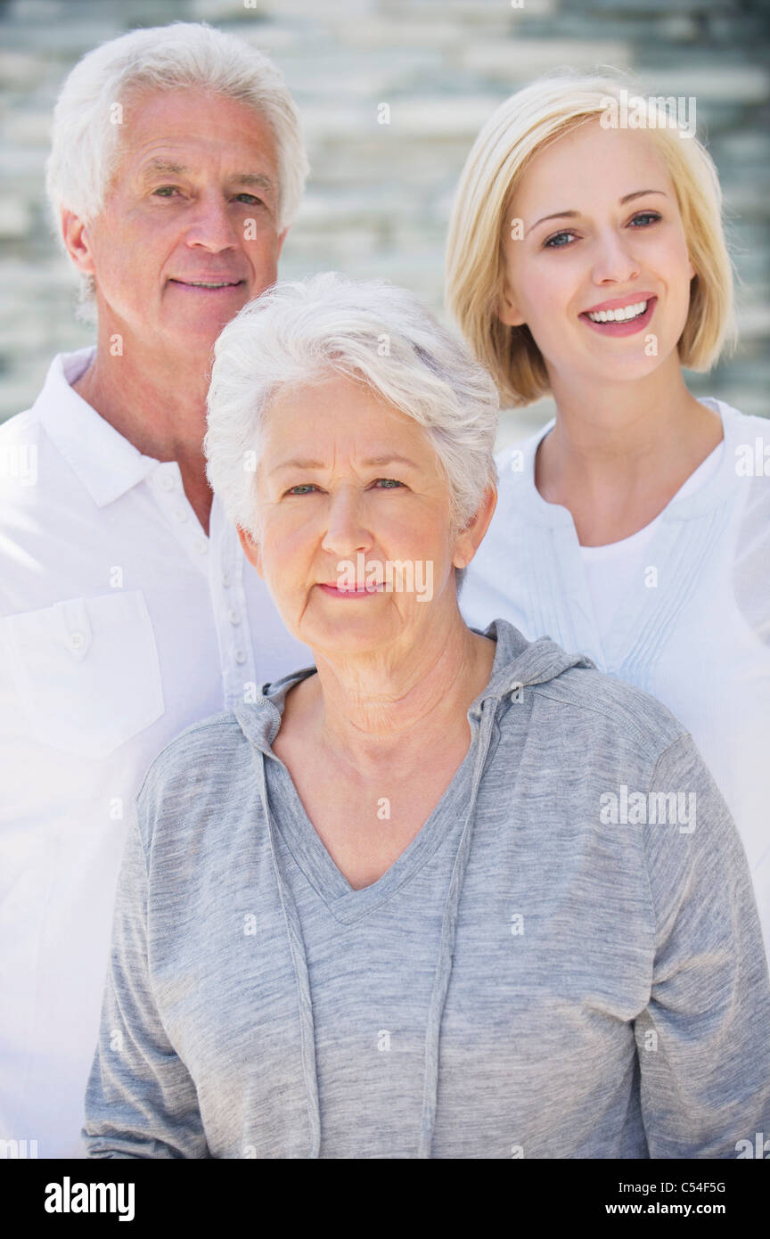 Young woman smiling with her parents - Stock Image